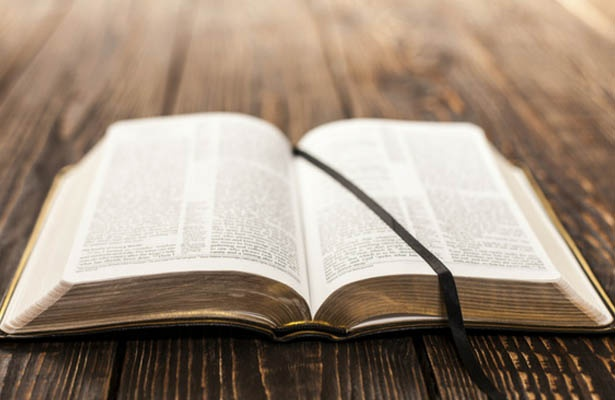 open-bible-on-table-615px-400px